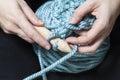 Two hands knitting stitch xxl crochet Stock Photos
