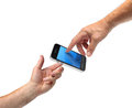 Two hands reaching smartphone Stock Photo