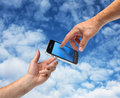 Two hands reaching smartphone Royalty Free Stock Images