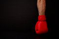 Two hands in red boxing gloves in the side of the frame on a black background,  empty space Royalty Free Stock Photo