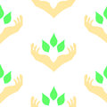 Two hands surrounding green leaves, seamless pattern Royalty Free Stock Photo