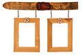 Two hanged wooden photo frames adorned with flowers and isolated on white background Royalty Free Stock Image