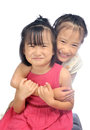 Two happy asian little sisters hugging siblings love together isolated on white background Royalty Free Stock Photography