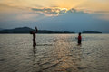 Two happy child fishing and play together petchaburi thailand march with laugh happiness with beautiful sun set at kengkrajarn Stock Photo