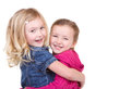 Two happy children hugging each other on an isolated white background Royalty Free Stock Photos