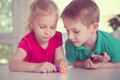 Two happy children playing with dices Royalty Free Stock Photo