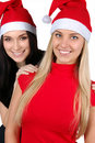 Two happy christmas girls isolated Royalty Free Stock Photography