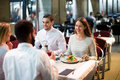 Two happy couples sitting at outdoor restaurant Royalty Free Stock Photo