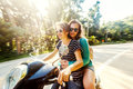 Two happy friends on a bike ride through the tropical jungle Royalty Free Stock Photo