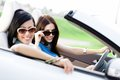 Two happy friends drive the car in driving everywhere and looking for freedom and fun Stock Photo