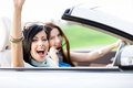 Two happy friends ride the cabriolet Royalty Free Stock Photography