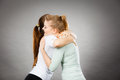 Two happy friends women hugging Royalty Free Stock Photo