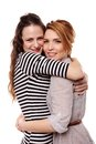 Two happy girlfriends hugging each other studio portrait of and smiling Royalty Free Stock Photo