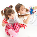 Two happy girls playing with finger colours Royalty Free Stock Image