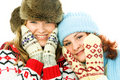 Two happy girls wearing warm winter clothes Royalty Free Stock Photos
