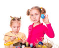 Two happy kids painting easter eggs. Happy Easter Royalty Free Stock Photos