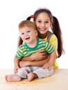 Two happy kids together hugging isolated on white Stock Photography