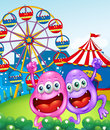 Two happy monsters near the carnival illustration of Stock Photo