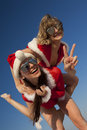 Two happy  Santa Clause having fun Royalty Free Stock Photography