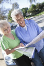 Two Happy Senior Women Reading Map Royalty Free Stock Photos