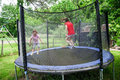 Two happy sisters on trampoline Royalty Free Stock Photo