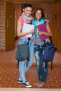 Two happy students posing in hallway school Royalty Free Stock Photography