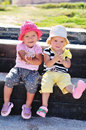 Two happy toddler girls having fun outdoors Royalty Free Stock Photo