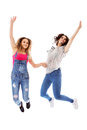 Two happy woman jumping together Royalty Free Stock Photo
