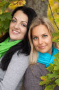 Two happy  women in autumn forest Stock Photography