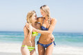 Two happy women embracing on the beach Royalty Free Stock Photo