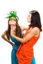 Two happy women play in venetian maquarade masks
