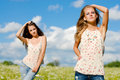 Two happy women posing outdoors Stock Photo