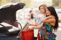 Two happy women shopping young with bags on the car parking Stock Photography