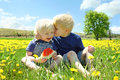 Two Happy Young Children Eating Watermelon in Flow Royalty Free Stock Photo