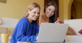 Two happy young women browsing the internet Royalty Free Stock Photo