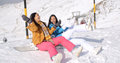 Two happy young women enjoying a winter holiday Royalty Free Stock Photo