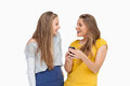 Two happy young women looking a smartphone Royalty Free Stock Photo