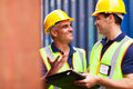Two harbor worker workers talking at container depot Royalty Free Stock Photos