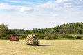 Two Hay Wagons in a Farm Field
