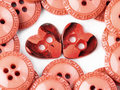 Two heart buttons Stock Photos