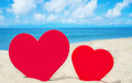 Two heart shape on the beach red sandy Royalty Free Stock Images