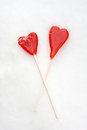 Two heart shape red lollipops Stock Image