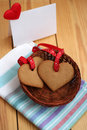 Two heart shaped cookie for valentines day hearts on a table Royalty Free Stock Photo
