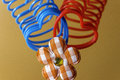 Two heart-shaped slinky toys intertwined with plaid flower decor Royalty Free Stock Photo