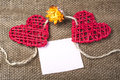 Two Hearts on burlap Background. Wedding Love Concept