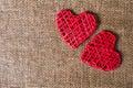 Two Hearts On Burlap Backgroun...