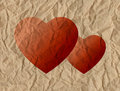 Two hearts on a crumpled paper Stock Images