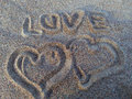Two hearts drawn in the sand Stock Photography