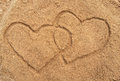 Two hearts drawn in the sand