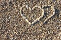 Two Hearts Laid Out Of Pebbles...